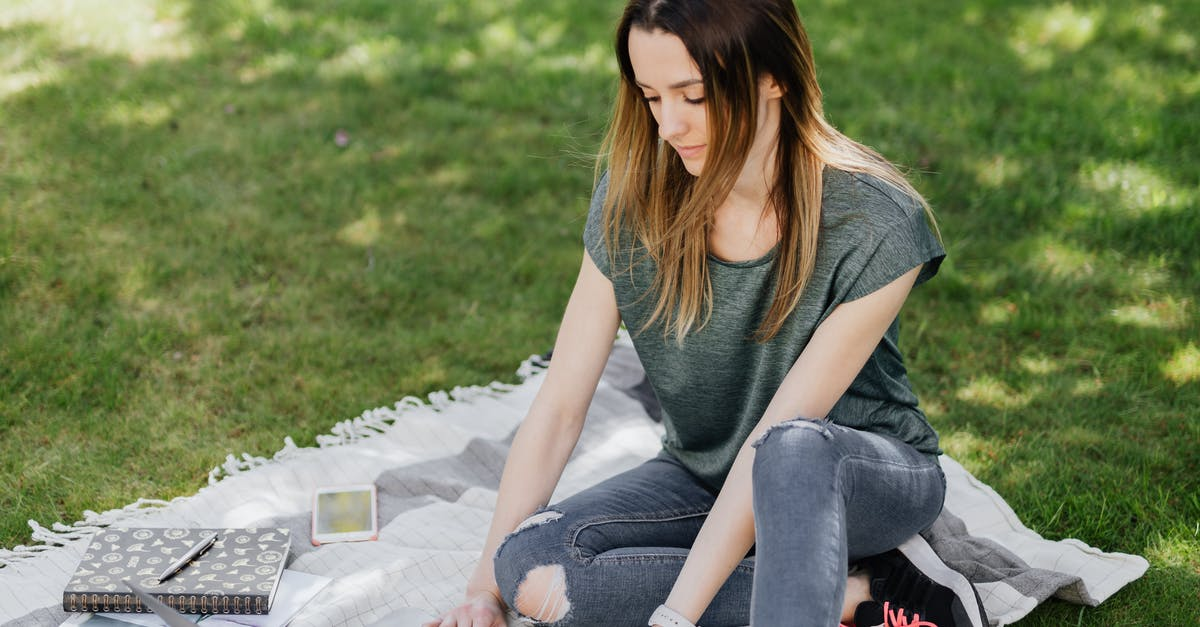 A woman sitting on the grass